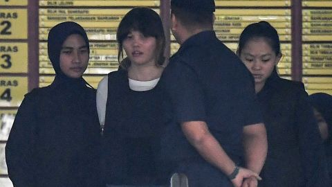 Royal Malaysian Police escort Vietnamese defendant Doan Thi Huong (2nd L) after her trial at the Shah Alam High Court in Shah Alam, outside Kuala Lumpur on October 2, 2017, for her alleged role in the assassination of Kim Jong-Nam, the half-brother of North Korean leader Kim Jong-Un.Two women pleaded not guilty on October 2 to murdering the half-brother of North Korea's leader at the start of their trial in Malaysia, as prosecutors alleged they practised for the Cold War-style assassination before carrying it out. / AFP PHOTO / MOHD RASFAN        (Photo credit should read MOHD RASFAN/AFP/Getty Images)