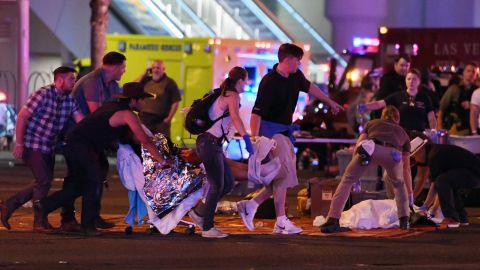 Victims of the shooting are tended to in the street.