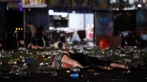People are seen on the ground after the gunman opened fire.