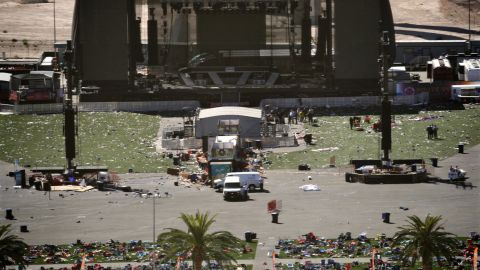 """Debris is scattered on the ground Monday, October 2, at the site of a country music festival held this past weekend in Las Vegas. Dozens of people were killed and hundreds were injured Sunday when <a href=""""http://www.cnn.com/2017/10/02/us/las-vegas-shooter/index.html"""" target=""""_blank"""">a gunman opened fire</a> on the crowd. Police said the gunman fired from the Mandalay Bay hotel, several hundred feet southwest of the concert grounds. It is the deadliest mass shooting in modern US history."""
