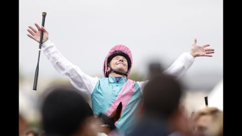 Frankie Dettori celebrates after riding Enable to win the Prix de l'Arc de Triomphe at Chantilly Racecourse on October 1, 2017 in Chantilly, France.