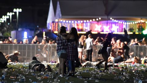 Concertgoers ran from the Route 91 Harvest country music festival on October 1, 2017 in Las Vegas, Nevada.