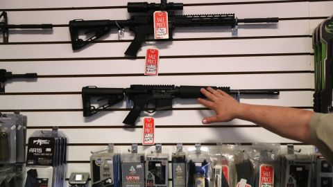 """BENSON, AZ - SEPTEMBER 29:  Gun shop owner Jeff Binkley displays AR-15 """"Sport"""" rifles at Sarge's Sidearms on September 29, 2016 in Benson, Arizona. He said he redesigned and renamed his store just this year. Gun shops are proliferate in Arizona, which regulates and restricts weapons less than anywhere in the United States.  (Photo by John Moore/Getty Images)"""