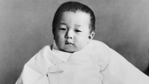 """In December 1933, Tsugunomiya Akihito was born to Emperor Hirohito and Empress Nagako. He was their fifth child and first son. According to Japanese legend, he is a direct descendant of Japan's first emperor Jimmu, circa 660 BC. Akihito means """"shining pinnacle of virtue,"""" and Tsugunomiya means """"prince of the august succession and enlightened benevolence."""""""