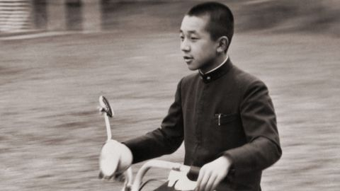 Akihito uses a scooter to whiz across the Imperial Palace grounds in 1948.