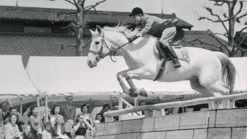 Akihito clears a hurdle during an equestrian event in Tokyo in 1952. It was staged as a send-off for Japanese Olympic riders.