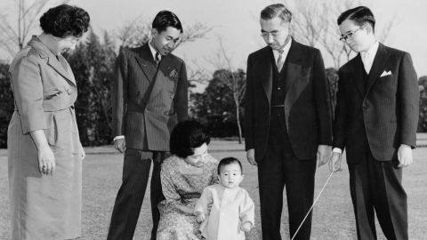 Members of the Japanese imperial family are photographed in 1961. Akihito is second from left, looking at his wife and their first son, Naruhito. They are joined by Akihito's parents, Emperor Hirohito and Empress Nagako, and his brother Masahito.