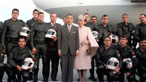 Akihito and Michiko pose with police officers who had escorted them at Brazil's Curitiba Airport in 1997.