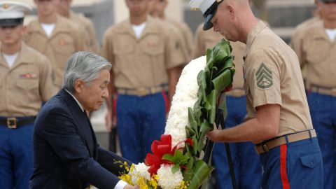 During a visit to Honolulu in 2009, Akihito lays a wreath at the National Memorial Cemetery of the Pacific. Akihito has repeatedly expressed remorse for his country's actions before and during World War II.