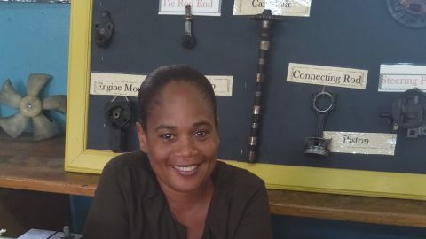 """Jamaican finalist Tracy-Ann Hall found school difficult herself, due to undiagnosed dyslexia. She first trained as an automotive technician and worked in a garage. This experience in training other learner mechanics gave her a lifelong love of teaching, and after further schooling she ended up teaching a group of students who had previously been written off as """"poor"""" and turned them into a great success."""