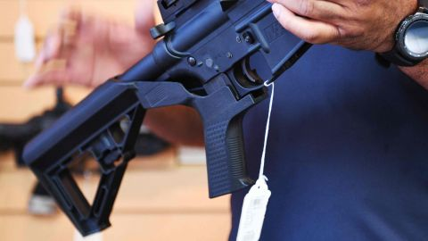 Senior Sales Staff Mark Warner shows a bump stock installed on an AR-15 rifle at Blue Ridge Arsenal in Chantilly, Virgina, on October 6, 2017. / AFP PHOTO / JIM WATSONJIM WATSON/AFP/Getty Images