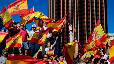 Protestors gather holding Spanish flags during a demonstration against independence of Catalonia called by DENAES foundation for the Spanish Nation Defence on October 07, 2017 in Madrid.