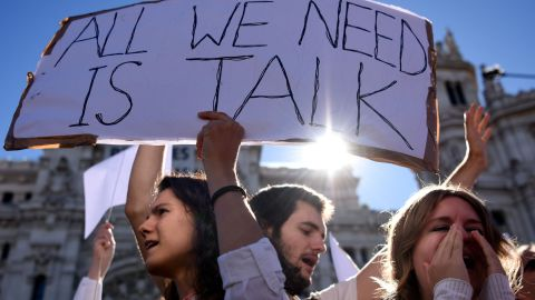Demonstrators urge a peaceful dialogue to resolve the crisis over Catalan independence on Saturday, October 7, in Madrid, Spain.
