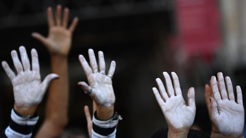People show their hands painted in white during a demonstration urging dialogue on October 7 in Madrid.  Neither the Catalan regional government nor the national government in Madrid has been willing to give ground since the referendum.