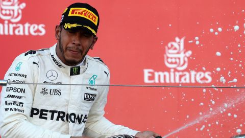 Champagne celebrations for Lewis Hamilton after his eighth victory of the F1 season for Mercedes.
