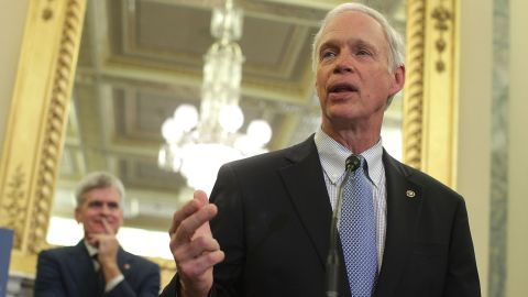 Sen. Ron Johnson (R-WI) (R) speaks as Sen. Bill Cassidy (R-LA) (L) listens during a news conference on health care September 13, 2017 on Capitol Hill in Washington, DC.
