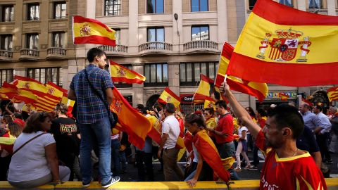 Protesters hold Spanish flags during a demonstration against independence for Catalonia on October 8.