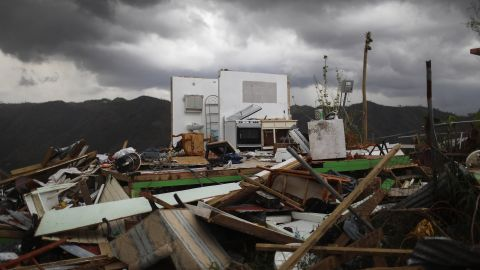 MOROVIS, PUERTO RICO - OCTOBER 06:  The remnants of a destroyed home stand more than two weeks after Hurricane Maria hit the island on October 6, 2017 in Morovis, Puerto Rico. Less than 11 percent of Puerto Ricans have electricity currently and only 42 percent have working phones. Puerto Rico experienced widespread damage including most of the electrical, gas and water grid as well as agriculture after Hurricane Maria, a category 4 hurricane, swept through.  (Photo by Mario Tama/Getty Images)