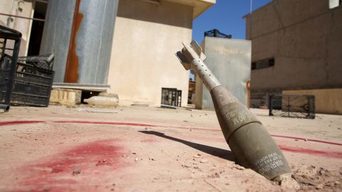 A 60mm mortar sits stuck in a roof in Mosul, Iraq, on September 11.
