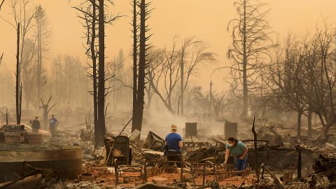 Santa Rosa residents sift through the remains of a burned home on October 9.