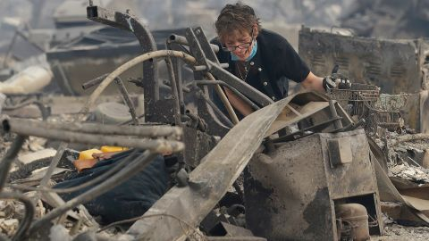 Kristine Pond searches what's left of her family's home in Santa Rosa on October 9.