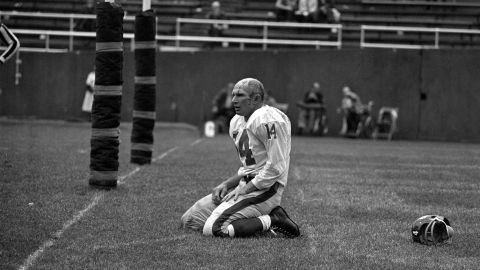 """Hall of Fame football quarterback <a href=""""http://bleacherreport.com/articles/2737727-pro-football-hall-of-fame-qb-ya-tittle-dies-at-age-90"""" target=""""_blank"""" target=""""_blank"""">Y.A. Tittle </a>died October 8 at the age of 90. Tittle made the Pro Bowl seven times over his 17-year career, and he was the NFL's MVP in 1963. In this photo, Tittle squats on the field after being hit hard during a game against the Pittsburgh Steelers in 1964. This became an iconic photograph that helped cement Tittle's name in football history."""