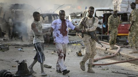 A Somali soldier helps a civilian who was wounded in a blast. Shaken residents called it the most powerful explosion they'd heard in years.