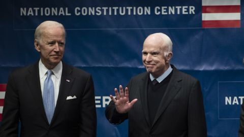 Sen. John McCain, R-Ariz., right, accompanied by Chair of the National Constitution Center's Board of Trustees, former Vice President Joe Biden, waves as he takes the stage before receiving the Liberty Medal in Philadelphia, Monday, Oct. 16, 2017. The honor is given annually to an individual who displays courage and conviction while striving to secure liberty for people worldwide. (AP Photo/Matt Rourke)