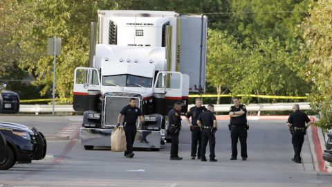 San Antonio police officers investigate the scene on July 23 after the immigrants were found.