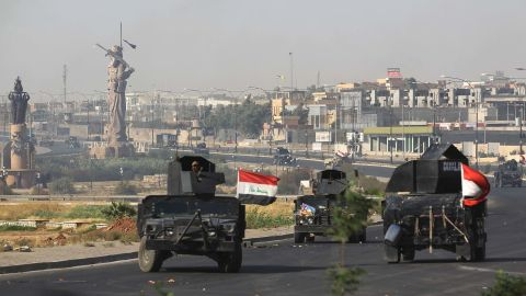 Iraqi forces advance to the center of Kirkuk during the operation against Kurdish fighters.