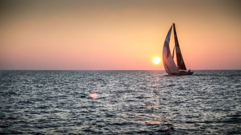 AT SEA - JANUARY 7: In this handout image provided by the Volvo Ocean Race, onboard Abu Dhabi Ocean Racing. A silhouetted Team Alvimedica behind an Indian Ocean Sunset as Abu Dhabi Ocean Racing rolls underneath them into third place during Leg 3 Abu Dhabi, UAE and Sanya, China. The Volvo Ocean Race 2014-15 is the 12th running of this ocean marathon. Starting from Alicante in Spain on October 11, 2014, the route, spanning some 39,379 nautical miles, visits 11 ports in 11 countries (Spain, South Africa, United Arab Emirates, China, New Zealand, Brazil, United States, Portugal, France, the Netherlands and Sweden) over nine months. The Volvo Ocean Race is the world's premier ocean race for professional racing crews. (Photo by Matt Knighton/Abu Dhabi Ocean Racing/Volvo Ocean Race via Getty Images)