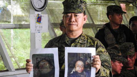 Philippine military chief General Eduardo Ano shows images of militant leaders Isnilon Hapilon and Omar Maute.