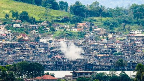 Smoke billows from destroyed buildings after troops fired mortars at ISIS position in Marawi, October 15, 2017.