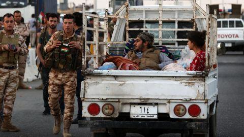 Iraqi families flee violence in Kirkuk province in October, 2017.