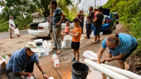Without running water at home, many people resorted to collecting supplies from mountain springs and streams, as here in Las Marias last October.