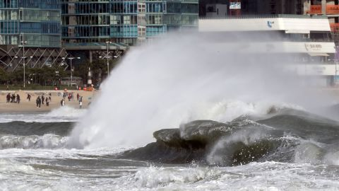 Enormous waves crash onto the coast of Busan, South Korea, on Sunday. Fishing boats were forbidden from going out to sea.