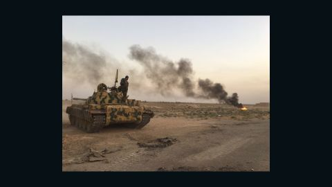 SDF tank on the frontline with ISIS. The smoke is from a smoke screen they created to conceal their positions from jihadists.