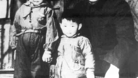 XI, left, stands with his father, Xi Zhongxun, and his younger brother, Xi Yuanping, in 1958. Xi Zhongxun was a communist revolutionary who held several positions in the National People's Congress.
