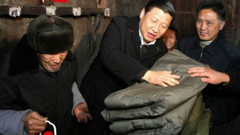 Xi brings blankets to a villager after ice storms in 2008. That year, Xi became China's vice president.