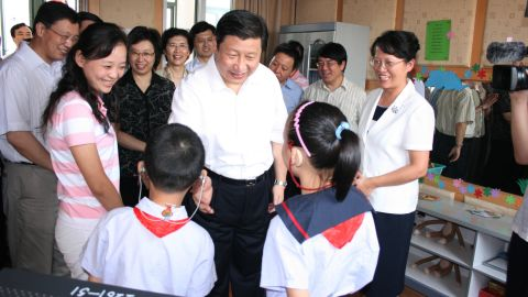 Xi talks with hearing-impaired students at a school in Shanghai in 2007.