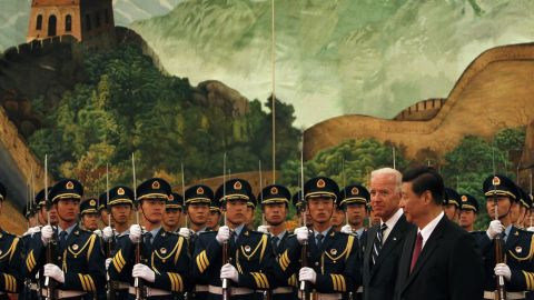 Xi and US Vice President Joe Biden inspect an honor-guard contingent during a welcoming ceremony in Beijing in 2011.