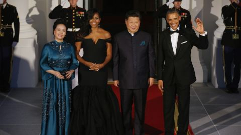 Xi and Peng pose with the Obamas before a state dinner in Washington in 2015.