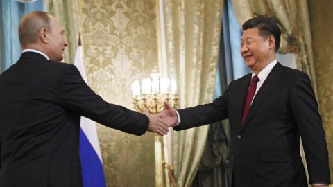 Xi shakes hands with Russian President Vladimir Putin before a meeting in Moscow in July 2017.