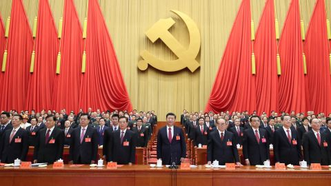 Xi, center, attends the closing session of the 19th National Congress in October 2017.