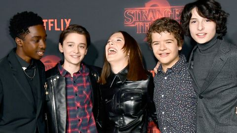 """LOS ANGELES, CA - OCTOBER 26:  (L-R) Caleb McLaughlin, Noah Schnapp, Millie Bobby Brown, Gaten Matarazzo, and Finn Wolfhard attend the premiere of Netflix's """"Stranger Things"""" Season 2 at Regency Bruin Theatre on October 26, 2017 in Los Angeles, California.  (Photo by Frazer Harrison/Getty Images)"""