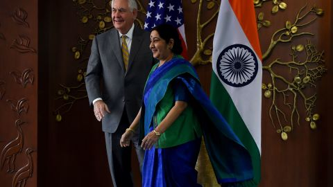 Indian Foreign Minister Sushma Swaraj (R) and US Secretary of State Rex Tillerson walk together before a meeting in New Delhi on October 25, 2017. US Secretary of State Rex Tillerson on October 25 started talks with Indian leaders expected to highlight the strong alliance between the two nations, with both anxious to counter China's growing influence. / AFP PHOTO / MONEY SHARMA        (Photo credit should read MONEY SHARMA/AFP/Getty Images)