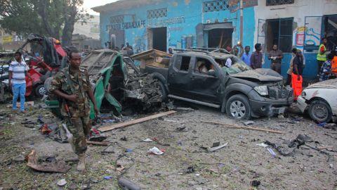 A Somali soldier is shown near wreckage from a car bomb detonated in Mogadishu, Somalia, on Saturday.