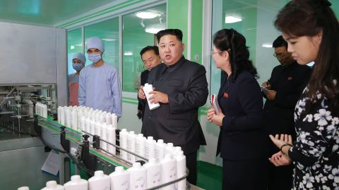 """This undated picture released from North Korea's official Korean Central News Agency (KCNA) on October 29, 2017 shows North Korean leader Kim Jong-Un (C) inspecting the Pyongyang Cosmetics Factory, as his wife Ri Sol-Ju (R) looks on. / AFP PHOTO / KCNA VIA KNS / STR / South Korea OUT / REPUBLIC OF KOREA OUT   ---EDITORS NOTE--- RESTRICTED TO EDITORIAL USE - MANDATORY CREDIT """"AFP PHOTO/KCNA VIA KNS"""" - NO MARKETING NO ADVERTISING CAMPAIGNS - DISTRIBUTED AS A SERVICE TO CLIENTS THIS PICTURE WAS MADE AVAILABLE BY A THIRD PARTY. AFP CAN NOT INDEPENDENTLY VERIFY THE AUTHENTICITY, LOCATION, DATE AND CONTENT OF THIS IMAGE. THIS PHOTO IS DISTRIBUTED EXACTLY AS RECEIVED BY AFP.  /         (Photo credit should read STR/AFP/Getty Images)"""