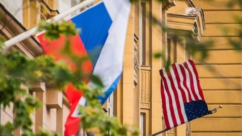 A Russian flag flies next to the US embassy building in Moscow on July 31, 2017. (MLADEN ANTONOV/AFP/Getty Images)