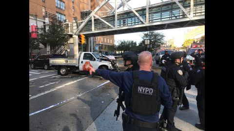 New York City police work in Manhattan after a rental truck drove down a busy bicycle path and struck people on Tuesday, October 31. At least eight people were killed in the incident, which is being investigated as terrorism, according to multiple law enforcement sources. A suspect is in custody.
